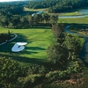 Aerial view of green #14 protected by bunker at Riverfront Golf Club