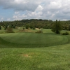 A view of a green with a bunker on the left at Rattlewood Golf Course