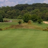 A view from a green with a narrow road on the left at Rattlewood Golf Course