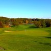 A view of a green with a bunker on the left at Trappers Turn Golf Club