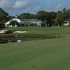 A view of the 2nd green protected by bunkers at Sugar Mill Country Club - Red Course
