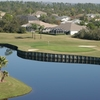 A view over the water of a green at Turtle Run Course from Sun 'n Lake Golf & Country Club