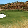 A view of the 5th green flanked by bunkers at Monte Rei Golf & Country Club - North Course