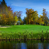 A fall view over the water of green at Mount Snow Golf Club