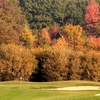 A fall view of green protected by bunkers at Willow Wood Golf Club
