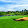 A view of a green with water coming into play at Flamingos Club de Golf