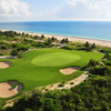 Aerial view of green guarded by bunkers at Playa Mujeres Golf Club