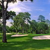A view of a green protected by bunkers at Houston Country Club