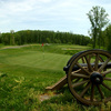 A cannon is positioned behind the 14th green at Cannon Ridge Golf Club in Fredericksburg, Va.