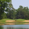 A view over the water of green protected by bunkers (courtesy of River Pointe Golf Club)