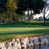 A view of green surrounded by water at Costa Mesa Golf & Country Club.