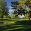 A view of green with water fountain on the left side at Fort Collins Country Club