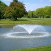 A view from River Bank Golf Course with water fountain in foreground