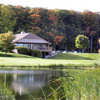 A view over the water of the clubhouse at Executive Golf Course at Bay Meadows Golf Course