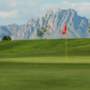 A view of a green with beautiful mountains in background at New Mexico State University Golf Course