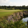A view of green #10 with waves coming into play at El Camaleon Mayakoba Golf Club