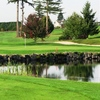A view over the water of the 8th green at Cedarcrest Golf Course