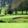 A view of the 11th hole flanked by bunkers at Cedarcrest Golf Course