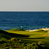 A view of a green with water in background from The Nicklaus Design Course at Vidanta Puerto Penasco