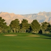 A sunrise view of a hole with mountains in background at Spanish Trail Country Club