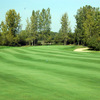 A view from fairway of a green flanked by sand traps at Rock Hollow Golf Club
