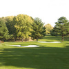 A view of a green protected by sand traps at Garrisons Lake Golf Club