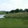 A view from a tee with water on the left at Boone Links Golf Course