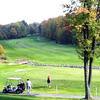 A fall view of fairway with narrow path in foreground at Hideout Golf Course