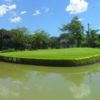 A view of green surrounded by water at Veterans Golf Club