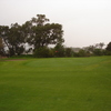 A view of green with bunker on the left at Strand Golf Club