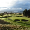 A view of green guarded by bunkers at Paraparaumu Beach Golf Club