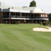 A view of a green and the clubhouse at Bardwell Valley Golf Club.