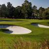 A view of green #4 guarded by bunkers at Concord Golf Club