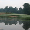 A view over the water of the 14th green at Rome Country Club