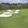 A view of a green with three white bunkers on the left side at Indooroopilly Golf Club