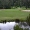 A view of green flanked by bunkers at Creekside Golf Club