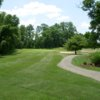 A view of green #8 with narrow path on the right at Sunset Golf Course