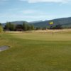 A view of a green guarded by bunker at Teton Reserve Golf Course.