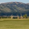 A view of a hole with mountains in background at Teton Reserve Golf Course
