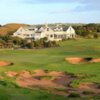A view of the clubhouse with a green in foreground at Dunes Golf Links