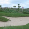A view of green protected by bunkers at Heritage Bay Golf & Country Club