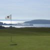 A sunny view of a hole at Dinard Golf Club