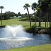 A view from Capri Isles Golf Club with water fountain in foreground