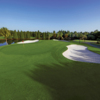 A view of green protected by bunkers at Lone Palm Golf Club