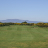 A view of green guarded by sand traps at Powfoot Golf Club