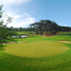 A view of green protected by bunker at Pine Lakes Country Club
