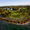 A view of green surrounded by water at West Course from TPC Dorado Beach