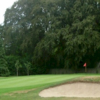 A view of a green protected by a bunker at Foxrock Golf Club