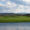 A view over the water of a green at Links at Cobble Creek