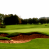 A view of a green protected by bunkers at Adlington Golf Centre.
